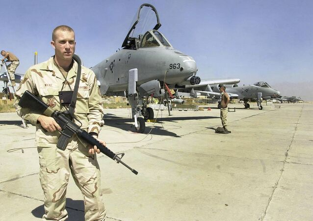 US troop stands guard in front of a line of jet fighter aircraft at the US-led coalition's Bagram Air Base north of Kabul (file photo)