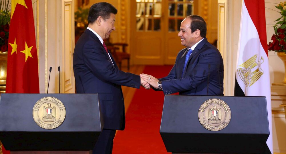 Egyptian President Abdel Fattah al-Sisi (R) and Chinese President Xi Jinping (L) shake hands after their joint press conference following their meeting in Cairo, Egypt, January 21, 2016, in this handout courtesy of the Egyptian Presidency. Picture taken January 21, 2016