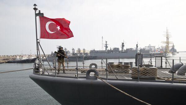 A Turkish marine serviceman stands on the deck of a Turkish navy TCG Turgutreis vessel - Sputnik International