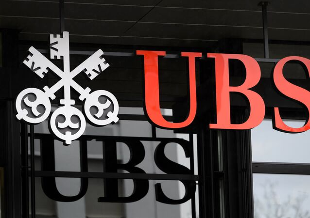 A picture taken on on January 12, 2016 shows the logo of the Swiss global financial services company UBS at the entrance of a branch's building in Zurich.