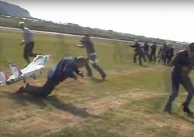 Man barely dives out of the RC plane's way