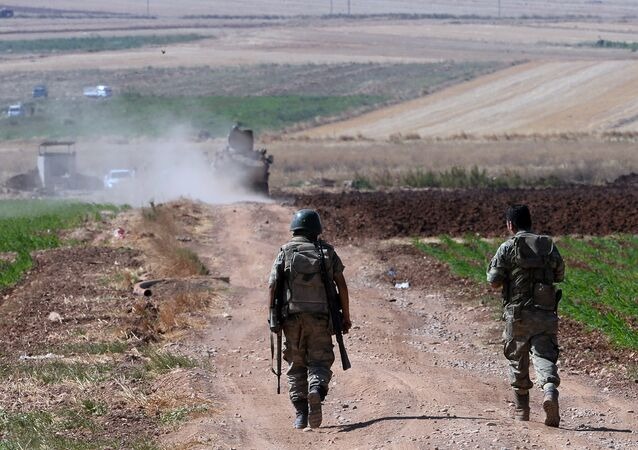 Turkish soldiers patrol near the border with Syria, ouside the village of Elbeyli, east of the town of Kilis, southeastern Turkey