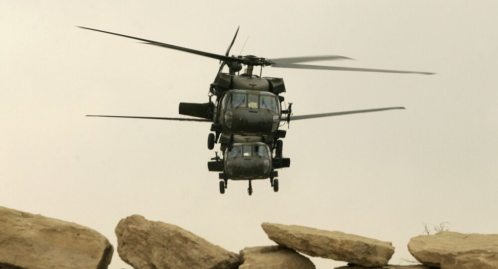 Two US military Black Hawk helicopters take off from its compound in the northern Iraqi city of Mosul (file photo)