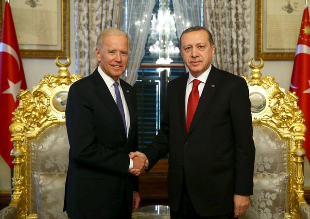 Turkish President Tayyip Erdogan (R) shakes hands with U.S. Vice President Joe Biden in Istanbul, Turkey January 23, 2016, in this handout photo provided by the Presidential Palace
