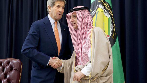 US Secretary of State John Kerry (L) and Saudi Foreign Minister Adel al-Jubeir shake hands after speaking to the media together at King Salman Regional Air Base in Riyadh, Saudi Arabia, January 23, 2016. - Sputnik International