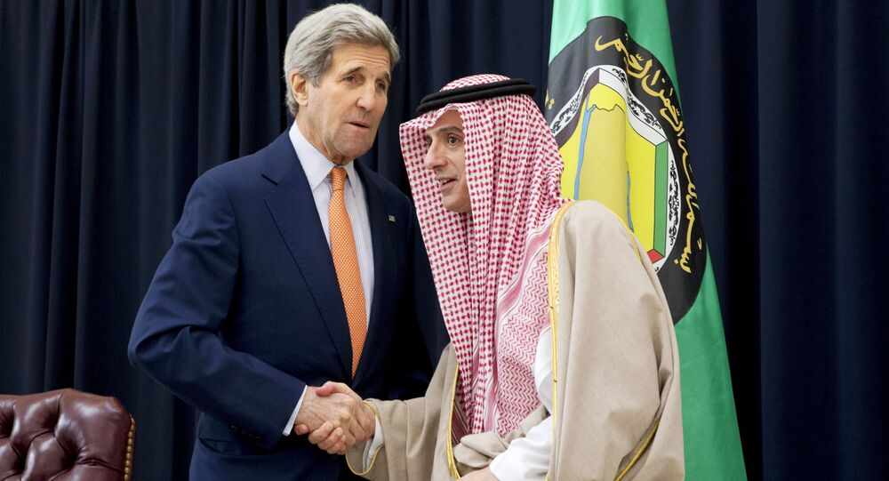 US Secretary of State John Kerry (L) and Saudi Foreign Minister Adel al-Jubeir shake hands after speaking to the media together at King Salman Regional Air Base in Riyadh, Saudi Arabia, January 23, 2016.