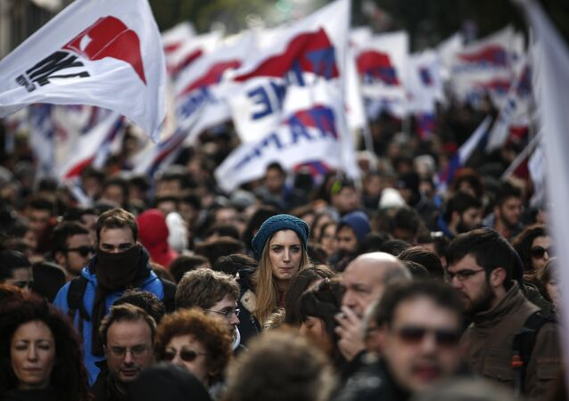 Supporters of the Communist-affiliated union PAME participate in a rally opposing planned reforms in the country's pension system in Athens, on Saturday, Jan. 23, 2016.