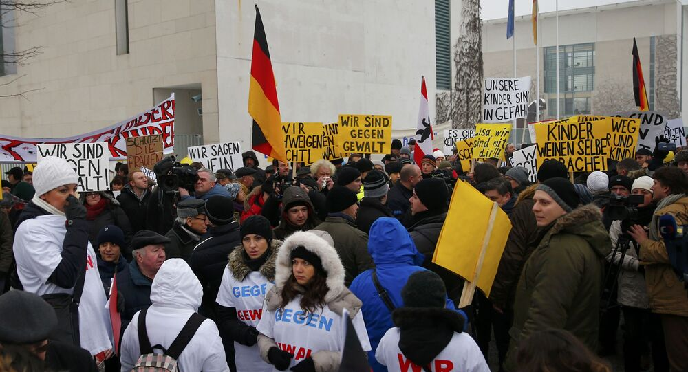 Activists and supporters of the 'International Convention of German Russians' protest against sexual harassment by migrants in front of the Chancellery in Berlin, Germany