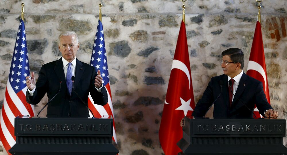 U.S. Vice President Joe Biden (L) speaks during a joint news conference with Turkish Prime Minister Ahmet Davutoglu in Istanbul, Turkey