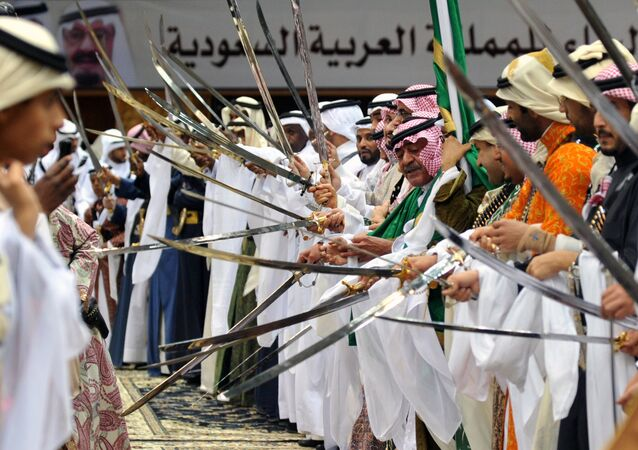 Saudi second deputy Prime Minister Mugren bin Abdulaziz (C-R) and unidentified Emirs perform during the traditional Saudi dancing best known as 'Arda' which performed during the Janadriya culture festival at Der'iya in Riyadh