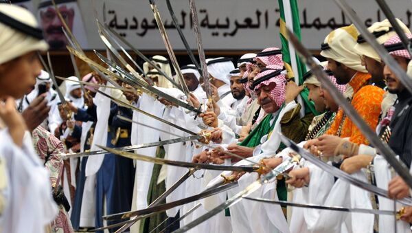Saudi second deputy Prime Minister Mugren bin Abdulaziz (C-R) and unidentified Emirs perform during the traditional Saudi dancing best known as 'Arda' which performed during the Janadriya culture festival at Der'iya in Riyadh - Sputnik International