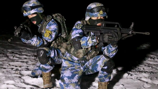 Soldiers of the People's Liberation Army (PLA) Marine Corps are seen in training at a military training base in Xinjiang Uighur Autonomous Region - Sputnik International