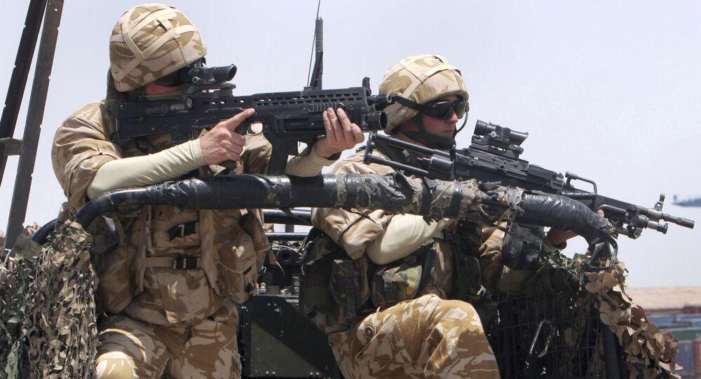 British soldiers stand guard at Umm Qasr port in Basra, Iraq