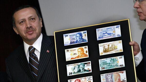 Recep Tayyip Erdogan holds a board featuring the new Turkish lira samples (File) - Sputnik International