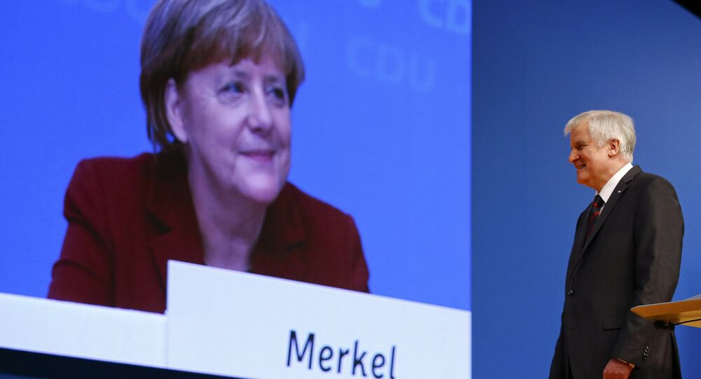 Angela Merkel is seen on a video screen as Horst Seehofer makes a speech at the CDU party congress in Karlsruhe, Germany in this December 15, 2015 file picture