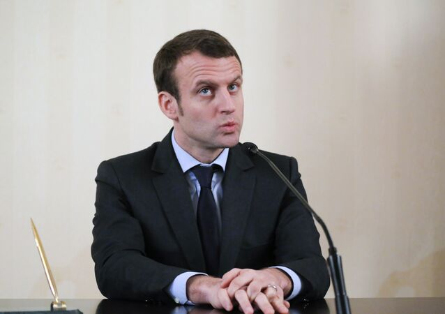 French Economy Minister Emmanuel Macron attends a meeting with the media after a session of the Russian-French Council for economic, financial, industrial and trade issues in Moscow. File photo.