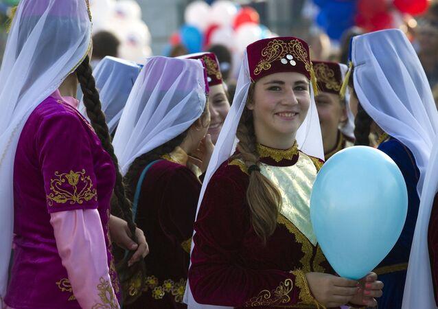 Women in national dresses on City Day in Sudak, Crimea