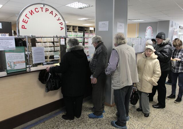 A line at the reception at a district medical center in St.Petersburg during a flu epidemic period. File photo
