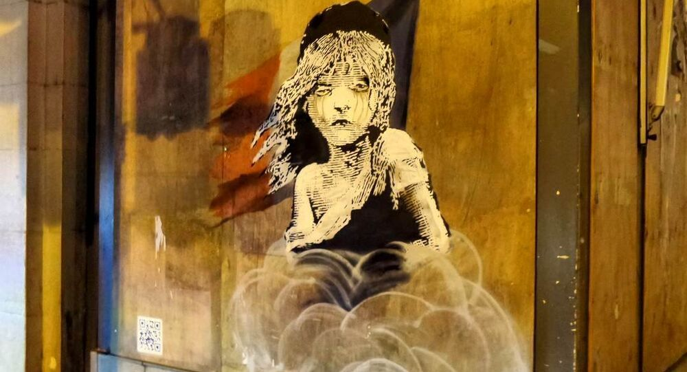 Banksy's mural opposite the French embassy in London highlighting the use of teargas on refugees by the French police.
