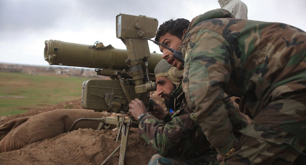Syrian pro-government forces adjust a man-portable anti-tank system (MANPAT) as they hold a position in the Hatabat al-Bab area, near town of Al-Bab in Aleppo's eastern countryside, on January 24, 2016, during a military operation against Islamic State (IS) group jihadists