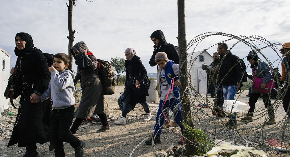 Migrants and refugees cross the Greek-Macedonian border near Gevgelija on November 15, 2015