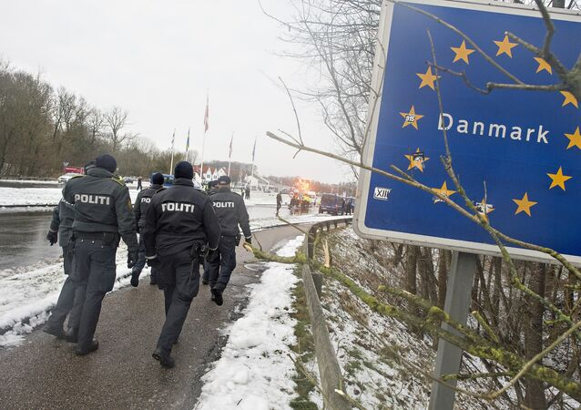 (FILES) This file photo taken on January 09, 2016 shows Danish police officers walking at the Danish-German border on January 9, 2016 in Krusaa, Denmark