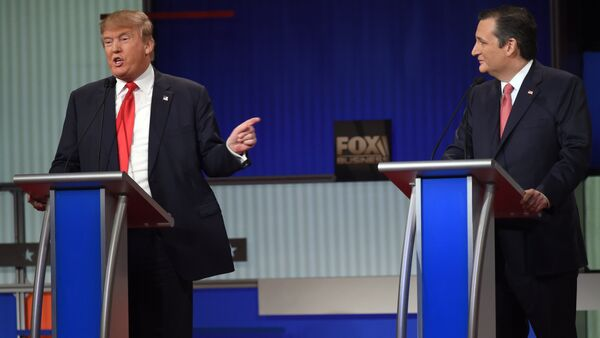 Republican Presidential candidate businessman Donald Trump (L) speaks next to Texas Senator Ted Cruz during the Republican Presidential debate sponsored by Fox Business and the Republican National Committee at the North Charleston Coliseum and Performing Arts Center in Charleston, South Carolina on January 14, 2016 - Sputnik International