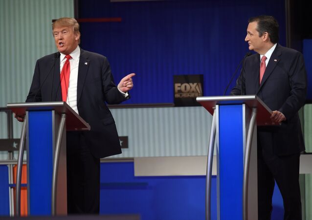 Republican Presidential candidate businessman Donald Trump (L) speaks next to Texas Senator Ted Cruz during the Republican Presidential debate sponsored by Fox Business and the Republican National Committee at the North Charleston Coliseum and Performing Arts Center in Charleston, South Carolina on January 14, 2016