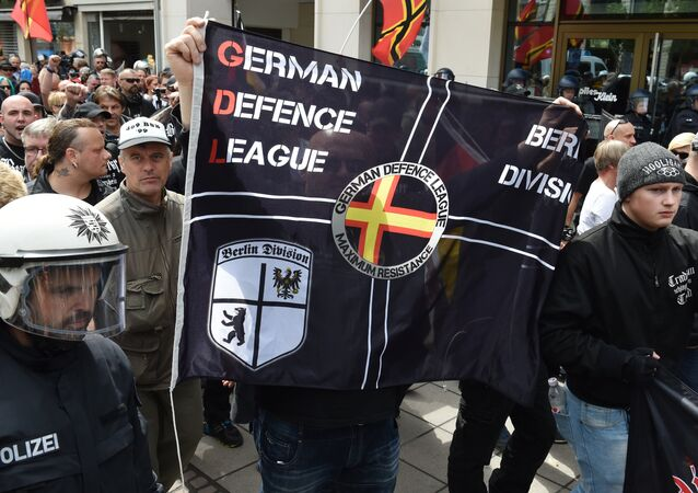 Right-extremists and hooligans take part in a rally of the initiative Widerstand Ost/West (Resistance East/West, WOW), a union of right-wing nationalists, Islamophobes and hooligans, on June 20, 2015 in Frankfurt am Main, western Germany