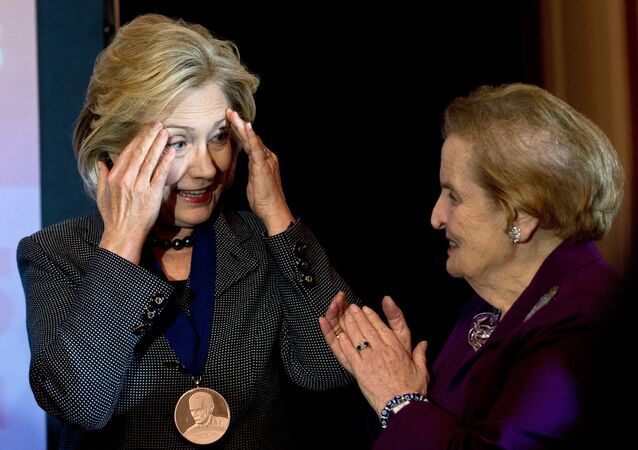Former US Secretary of State Hillary Clinton (L) speaks with former Secretary of State Madeleine Albright after receiving the 2013 Lantos Human Rights Prize during a ceremony on Capitol Hill in Washington on December 6, 2013