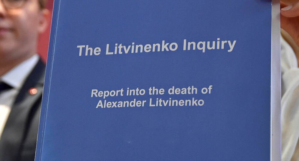 Marina Litvinenko, (R) widow of  Alexander Litvinenko, poses with a copy of The Litvinenko Inquiry Report with her son Anatoly (L) during a news conference in London, Britain, January 21, 2016.