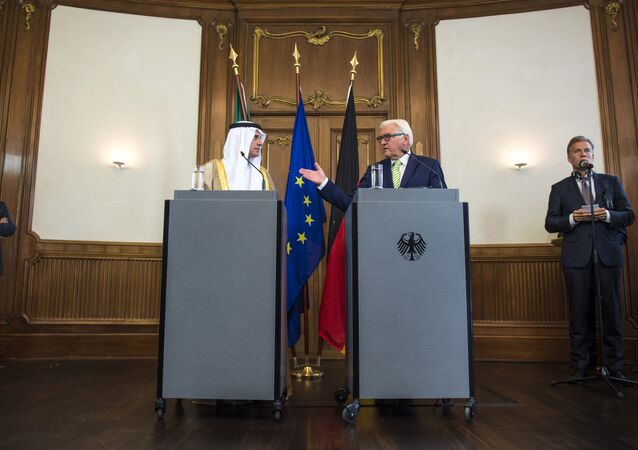 German Foreign Minister Frank-Walter Steinmeier (C, R) and his Saudi counterpart Adel Al-Jubeir (C, L) attend a press conference following talks at Villa Borsig, the official guest house of the foreign ministry, in Berlin on August 10, 2015