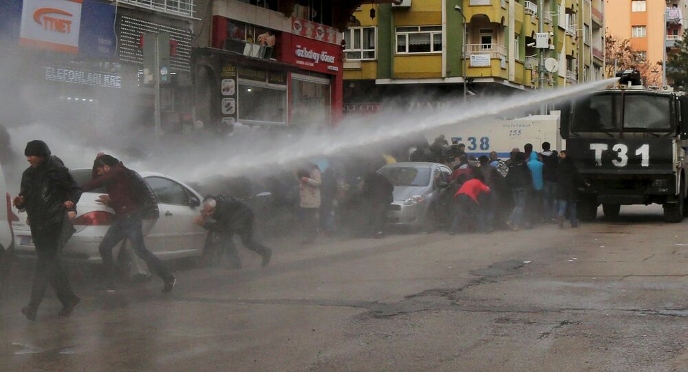 Turkish riot police use a water cannon to disperse Kurdish demonstrators during a protest against a curfew in Sur district and security operations in the region, in the southeastern city of Diyarbakir, Turkey January 17, 2016