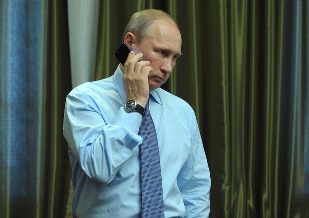 President Vladimir Putin talks over the phone