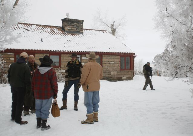 Supporters wait while a meeting takes place with Ammon Bundy, Ryan Bundy and the Pacific Patriots Network, who are attempting to resolve the occupation at the Malheur National Wildlife Refuge, near Burns, Oregon, January 9, 2016.