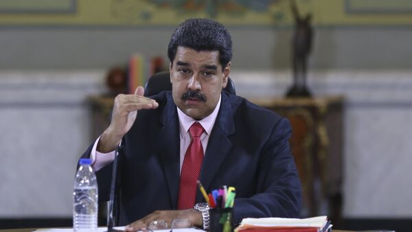 Venezuela's President Nicolas Maduro speaks during a meeting with deputies of Venezuela's United Socialist Party (PSUV) and ministers at Miraflores Palace in Caracas, in this handout picture provided by Miraflores Palace on January 22, 2016 - Sputnik International