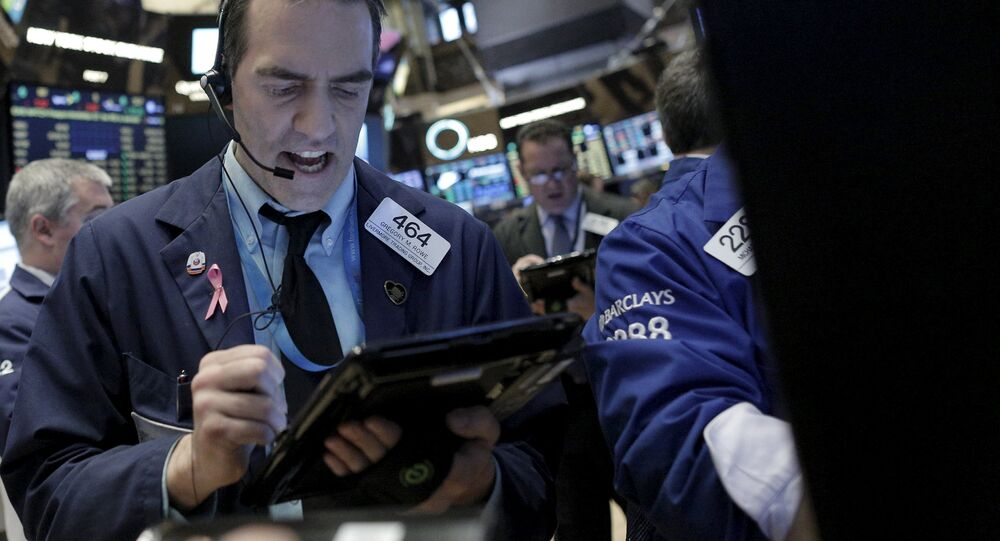 Trader Greg Rowe asks for a price from a Specialist trader at the Barclay's post on the floor of the New York Stock Exchange January 26, 2016