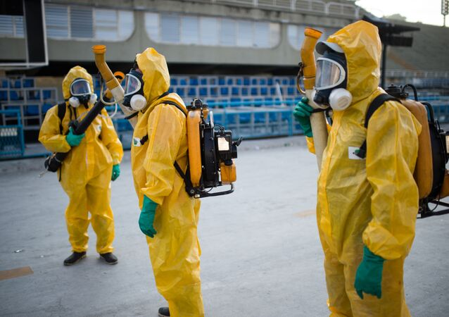 Municipal agents spray anti Zika mosquitos chimical product at the sambadrome in Rio de Janeiro, on January 26, 2016