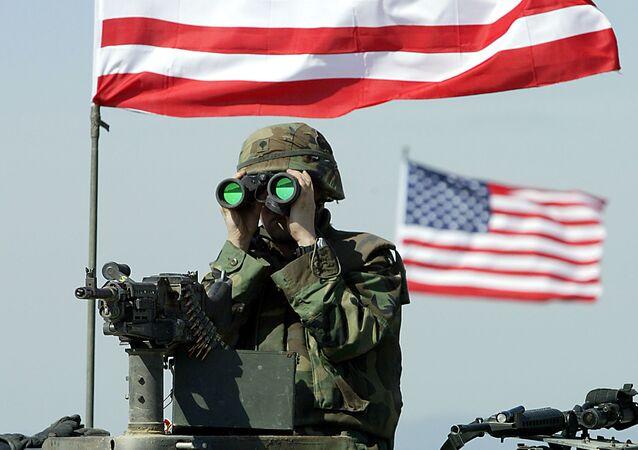 A US soldier peers through binoculars. file photo