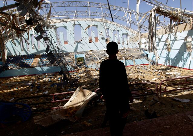 A Yemeni boy inspect the damage at a sports hall that was partially destroyed by Saudi-led air strikes in the Yemeni capital Sanaa on January 19, 2016.