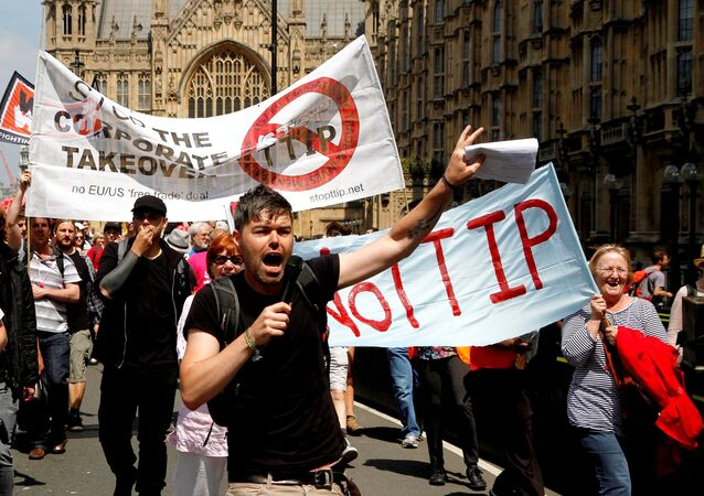 Protesters against the EU-US trade deal (TTIP - Transatlantic Trade and Investment Partnership) outside the Houses of Parliament march to Europe House, London, in 2014.