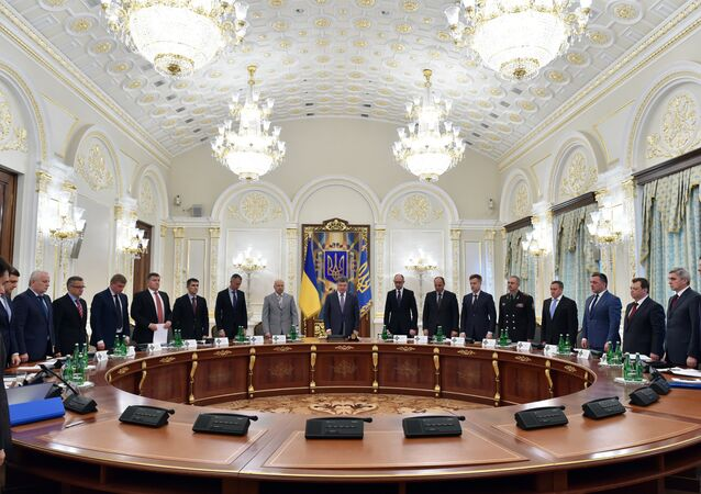 Ukrainian President Petro Poroshenko (C) and the other members of the National Security and Defence Council