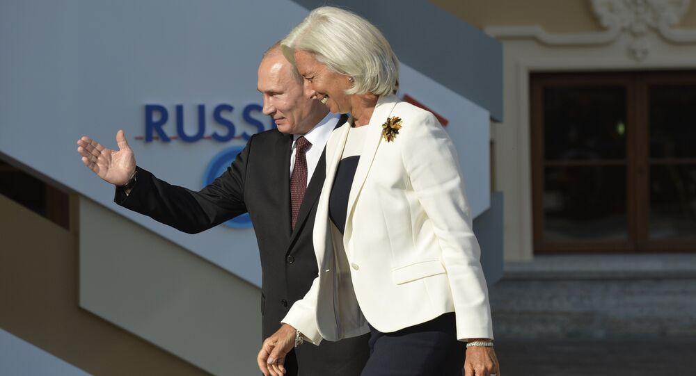 Russia's President Vladimir Putin (L) welcomes International Monetary Fund (IMF) Managing Director Christine Lagarde at the start of the G20 summit on September 5, 2013 in Saint Petersburg