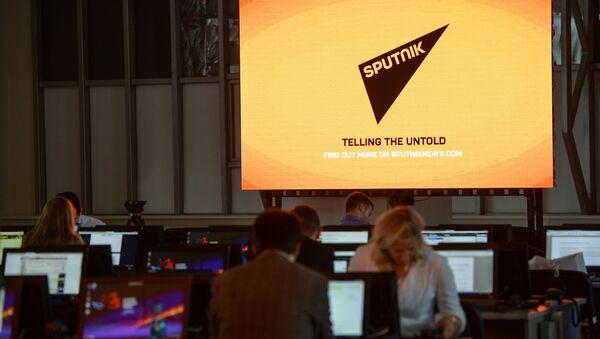 A screen featuring the logo of the Sputnik International News Agency and Radio seen at the media center of the Eastern Economic Forum, Vladivostok - Sputnik International