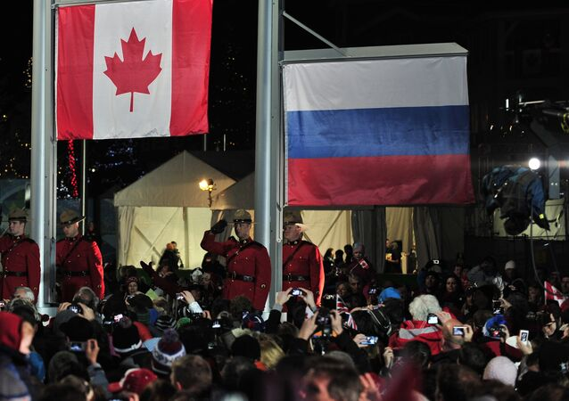 Canadian and  Russian flags