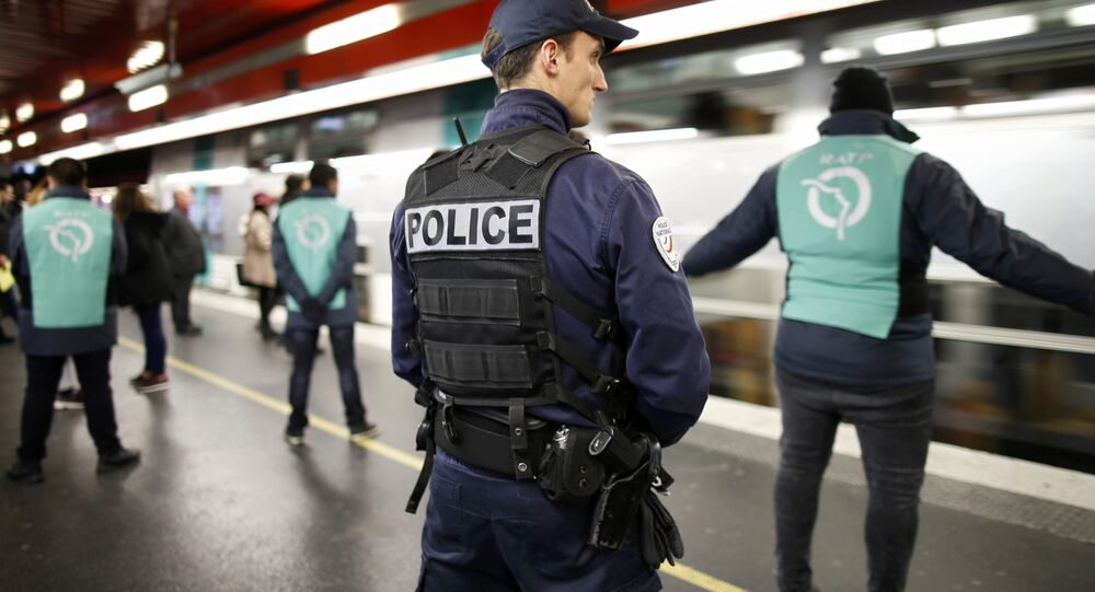 A policeman patrols inside the RER (suburban rapid transit) station of Auber in Paris, France, December 30, 2015, as a security alert continues during the Christmas and New Year holiday season following the November shooting attacks in the French capital.