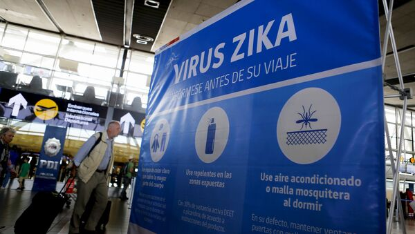 A banner is seen during an information campaign on Zika virus by the Chilean Health Ministry at the departures area of Santiago's international airport, Chile, January 28, 2016 - Sputnik International