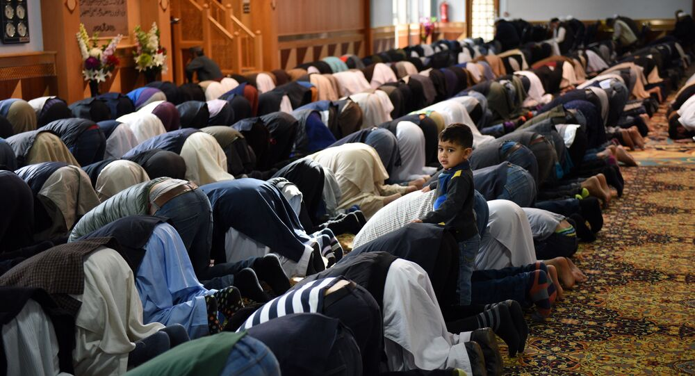 Muslims pray  in a mosque