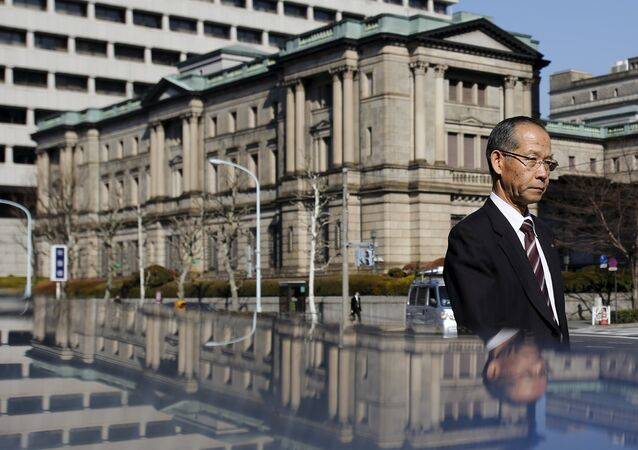 A man walks past the Bank of Japan building in Tokyo