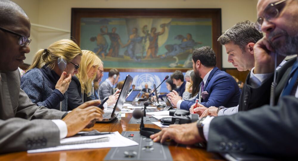 Jounalists attend a breifing at the United Nations Offices on the opening day of Syrian peace talks in Geneva